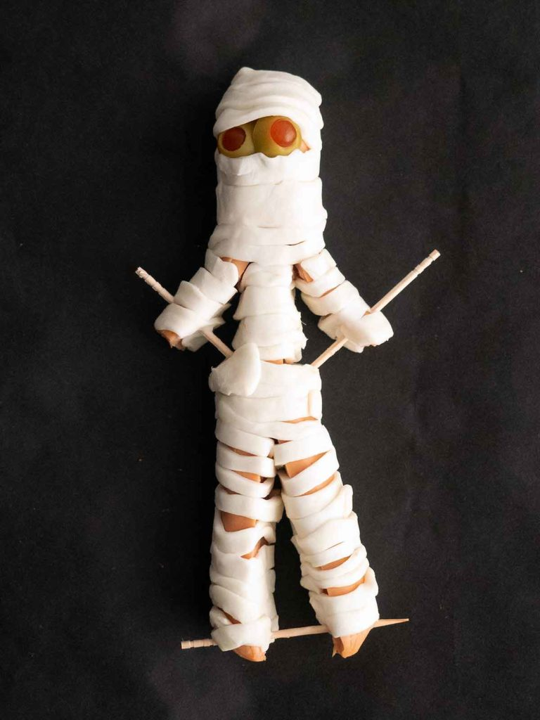 hot dog mummy with arms and legs secured by toothpicks