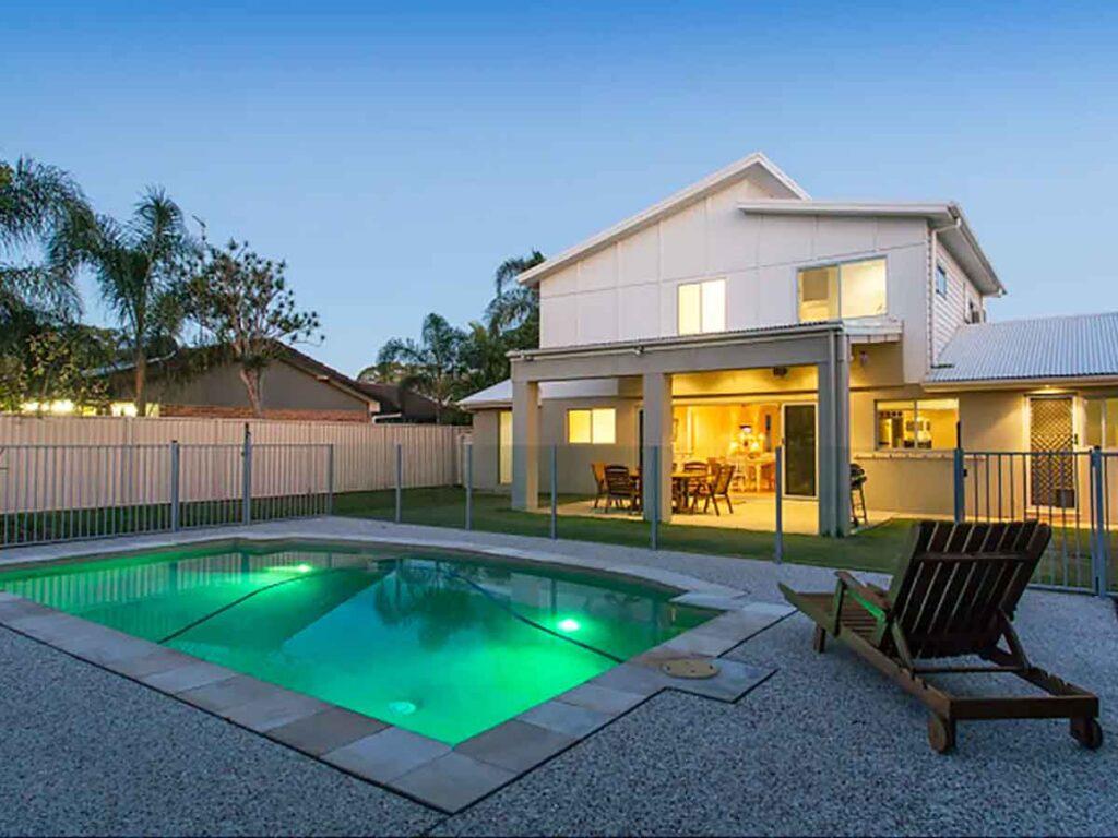 pool at night at back of house