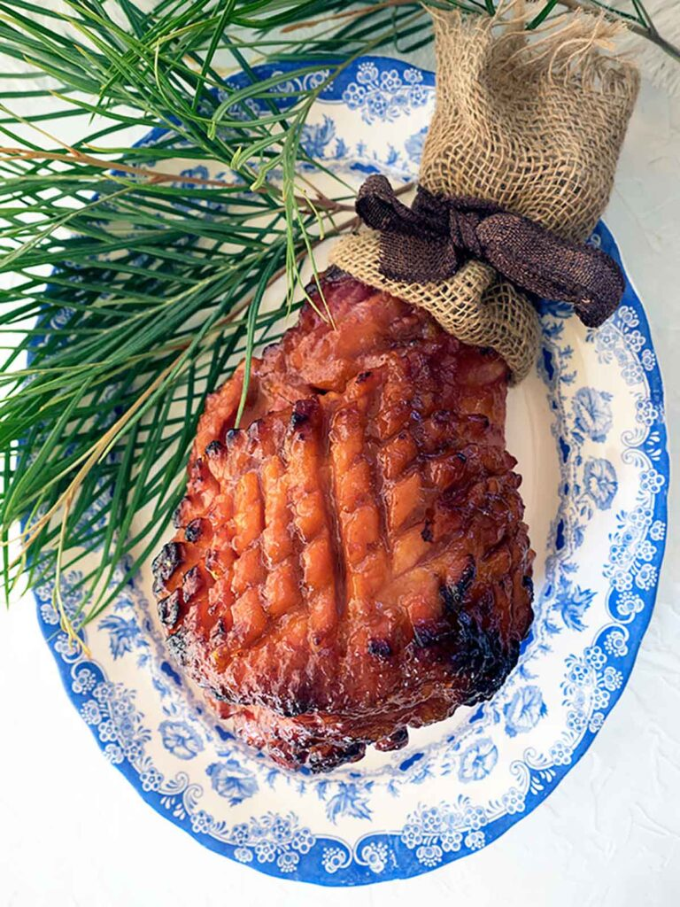 whole ham glazed and on serving plate