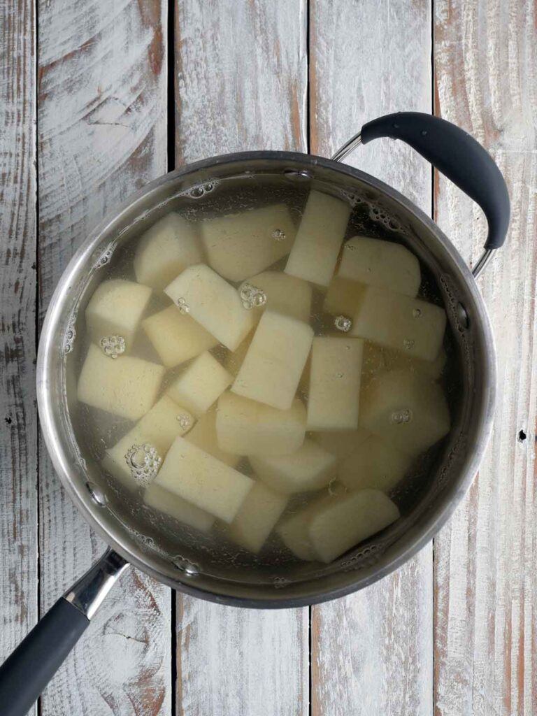 potatoes cut up in a pot ready to boil