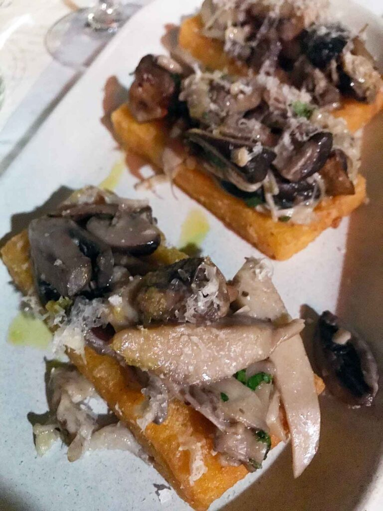 polenta fried and topped with mixed mushrooms