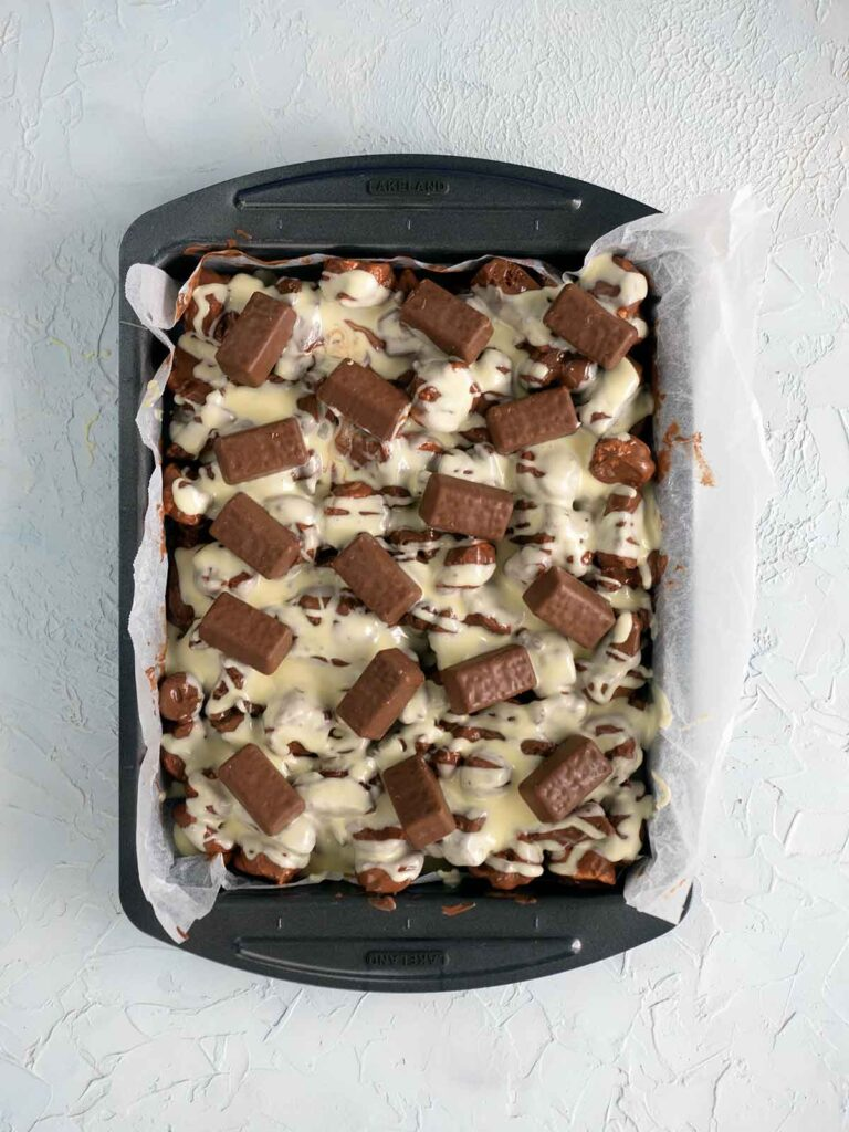 mini tim tams decorating the top of the tim tam rocky road