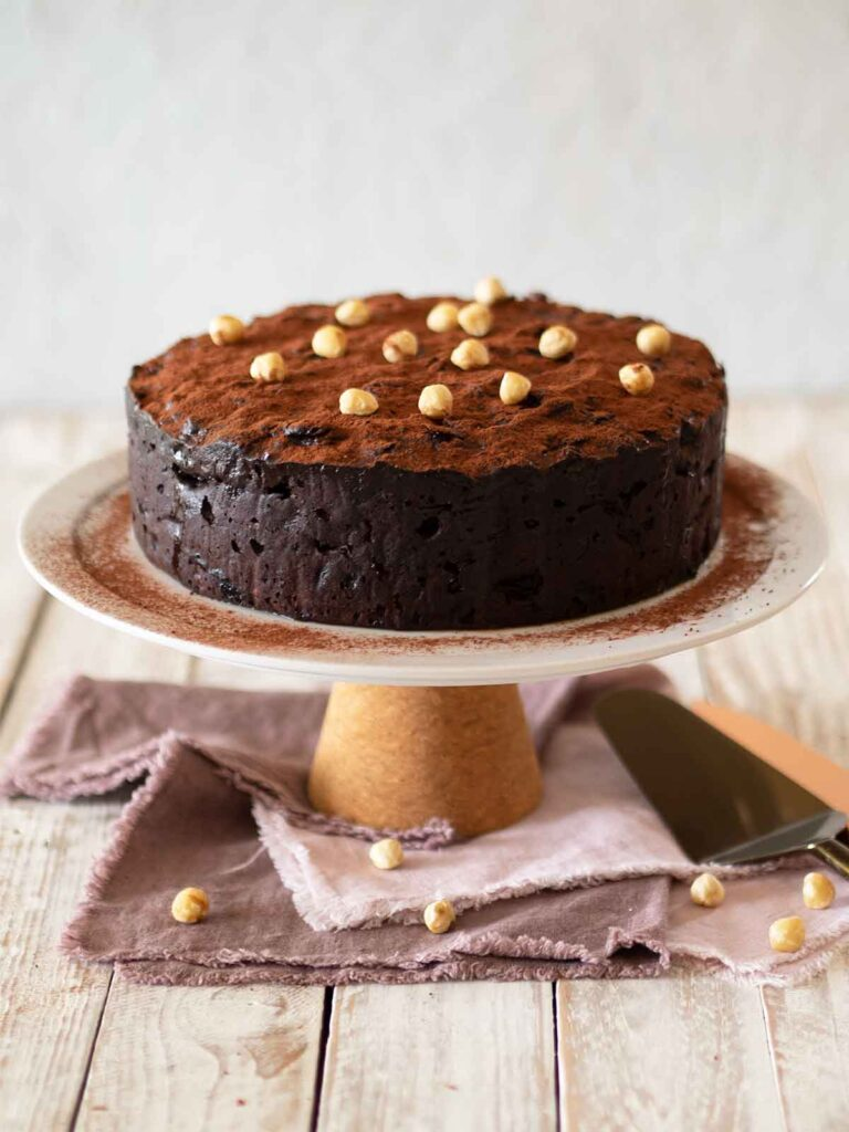 decorated hazelnut chocolate fruit cake on cake stand ready to serve