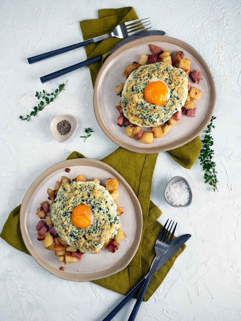 flat lay image of two plates of ham hash wth eggs sitting on top