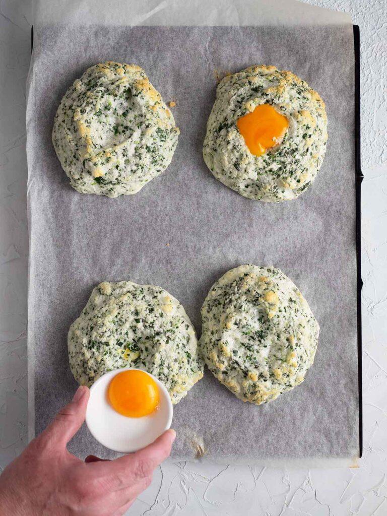placing egg yolks on top of semi baked egg whites