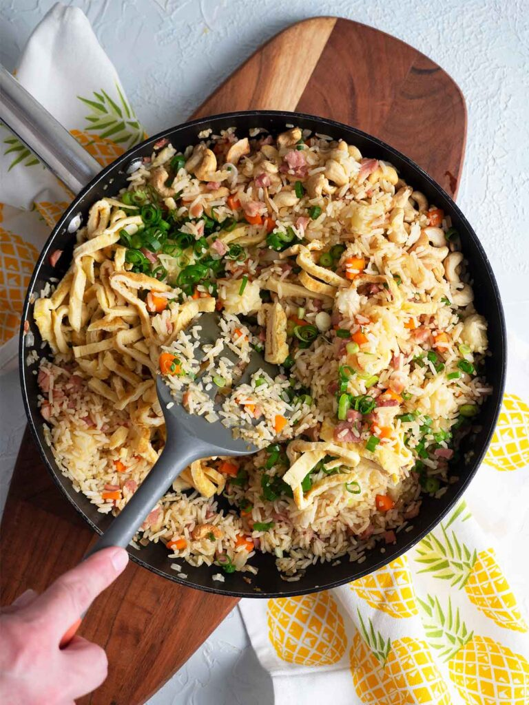 adding egg and scallions to the rice