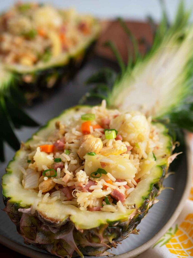 ham and pineapple fried rice served in half pineapples
