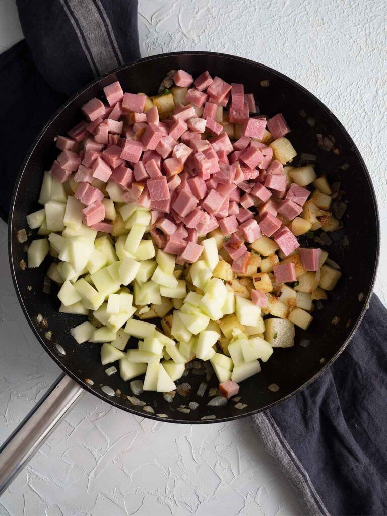 ham potatoes and onions in a fry pan