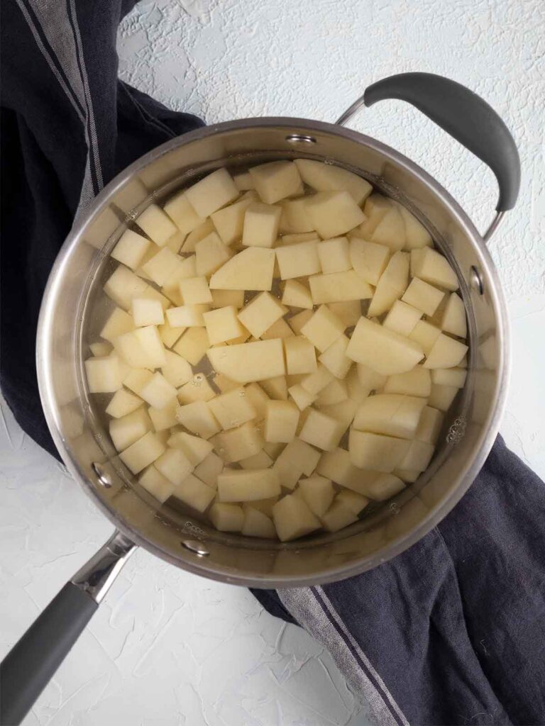 potatoes boiling in a pot of water