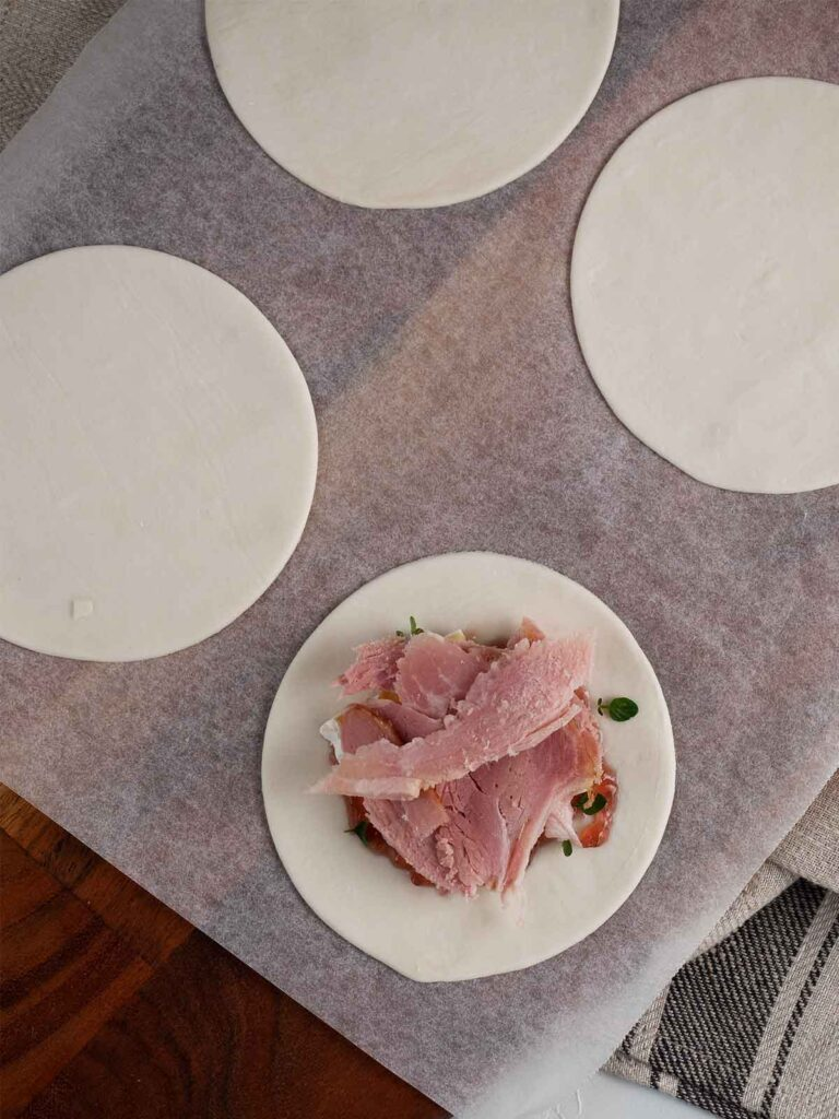 ham being added to the pie filling layer