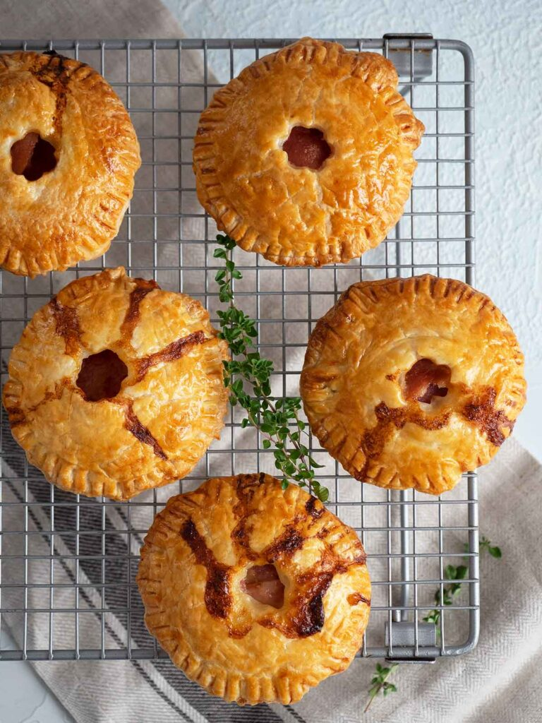 baked ham pies on a cake rack