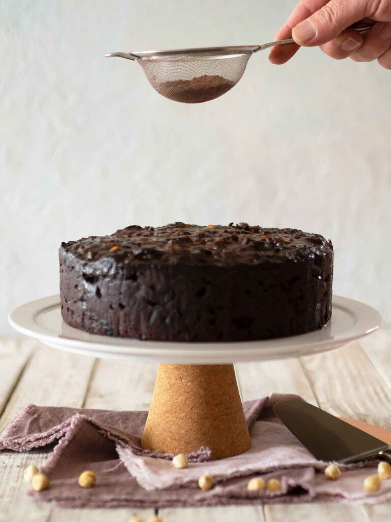 dusting cake with cocoa powder