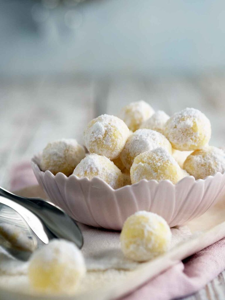white chocolate mint truffles in a pink bowl