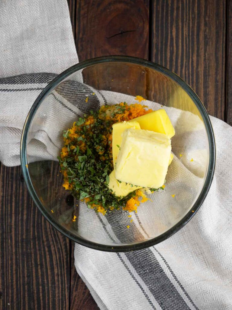 orange butter ingredients in a glass bowl