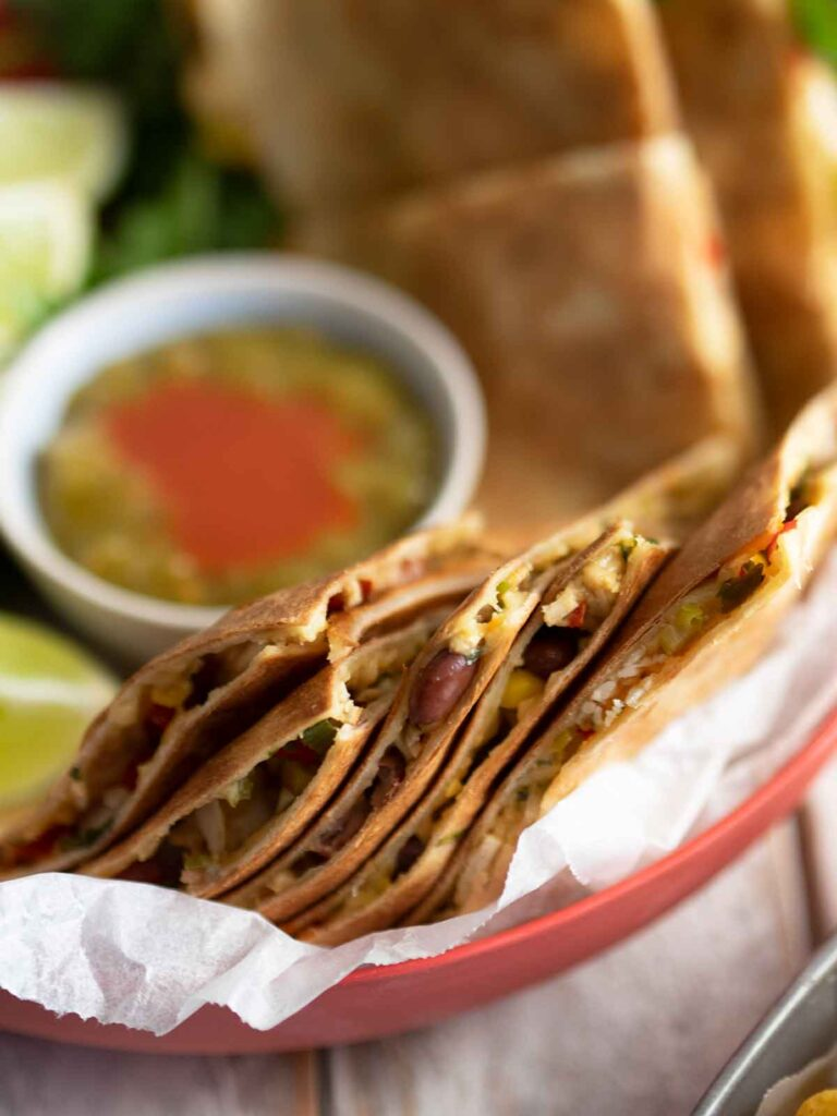 turkey quesadillas in a bowl with sauce