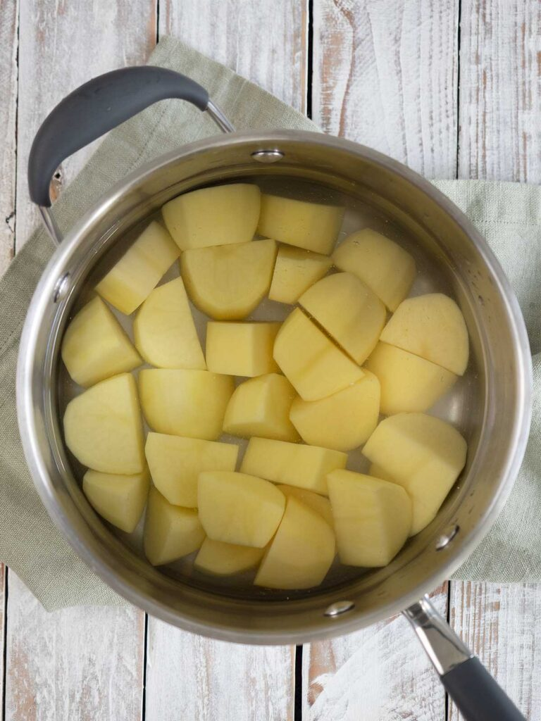 potatoes in a large pot with water ready to boil