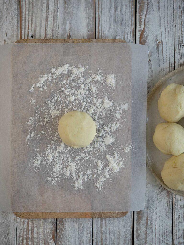 ball of dough on a floured surface