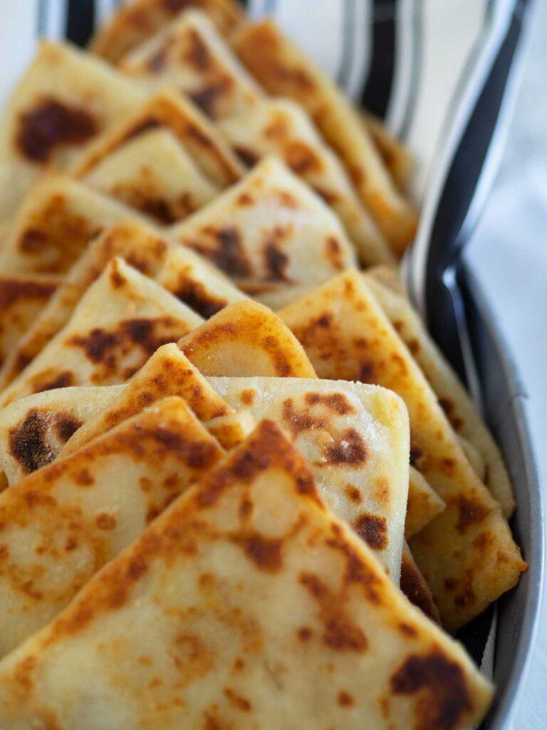 close up of triangles of Irish potato bread in a basket