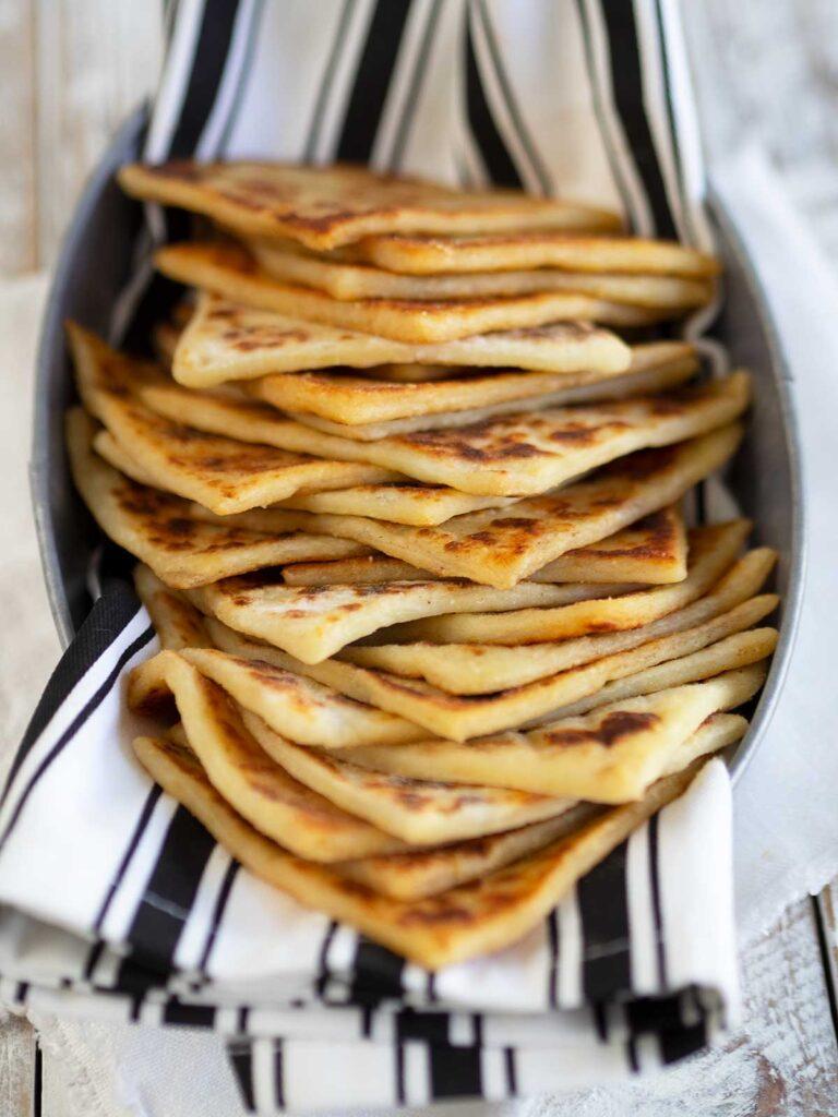 Irish potato bread in a basket with black and white striped cloth
