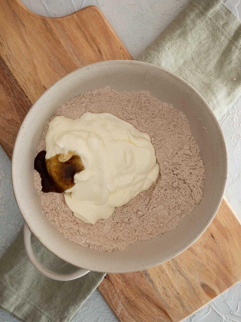 adding wet ingredients to bun dry ingredients