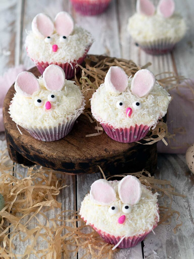 bunny cupcakes on a wooden board