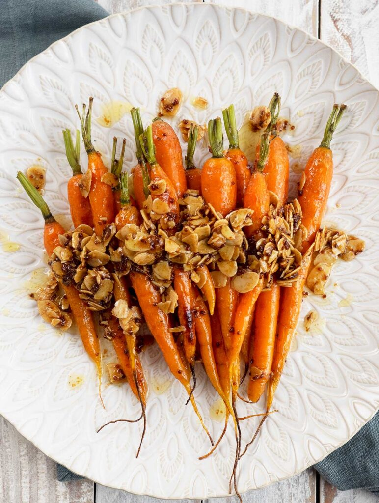 roasted dutch carrots on a white platter