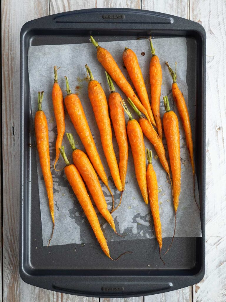 roasted dutch carrots on a baking tray