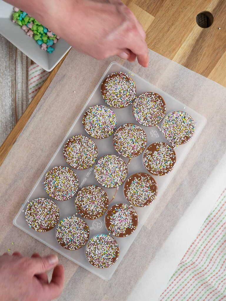 shaking excess sprinkles from moulds