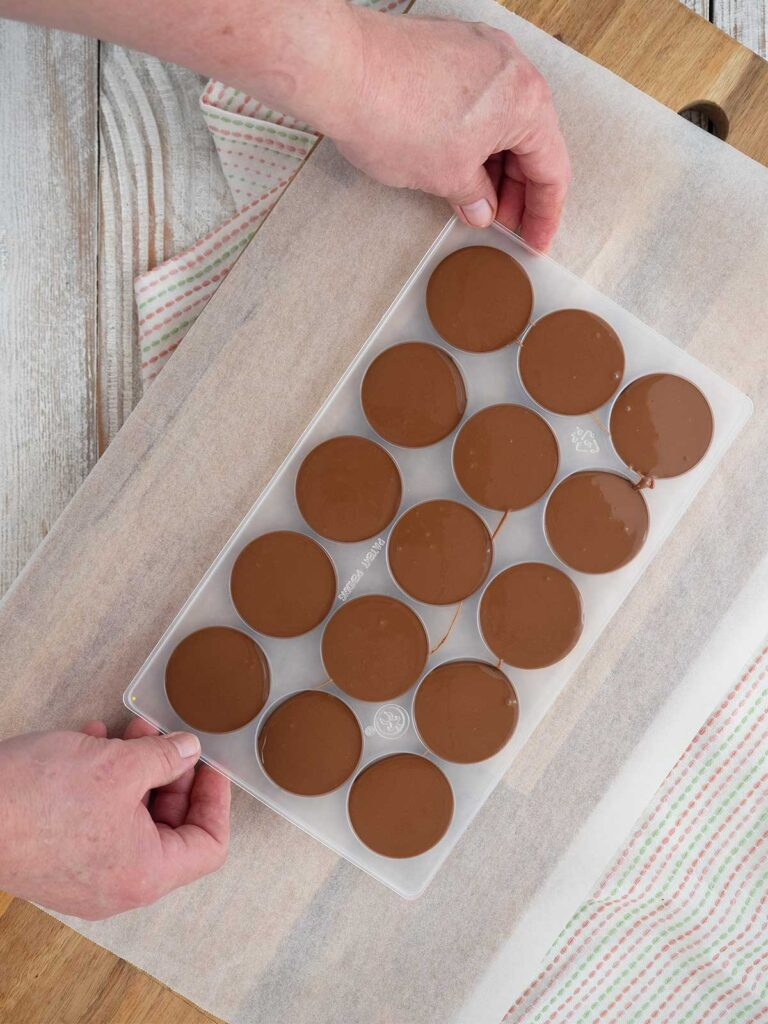 tapping the chocolate mould on a hard surface