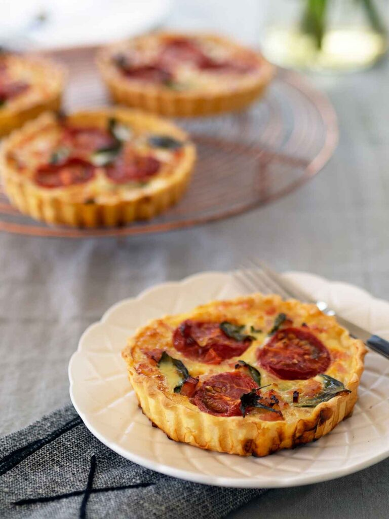 tomato tarts on a plat and cooling rack
