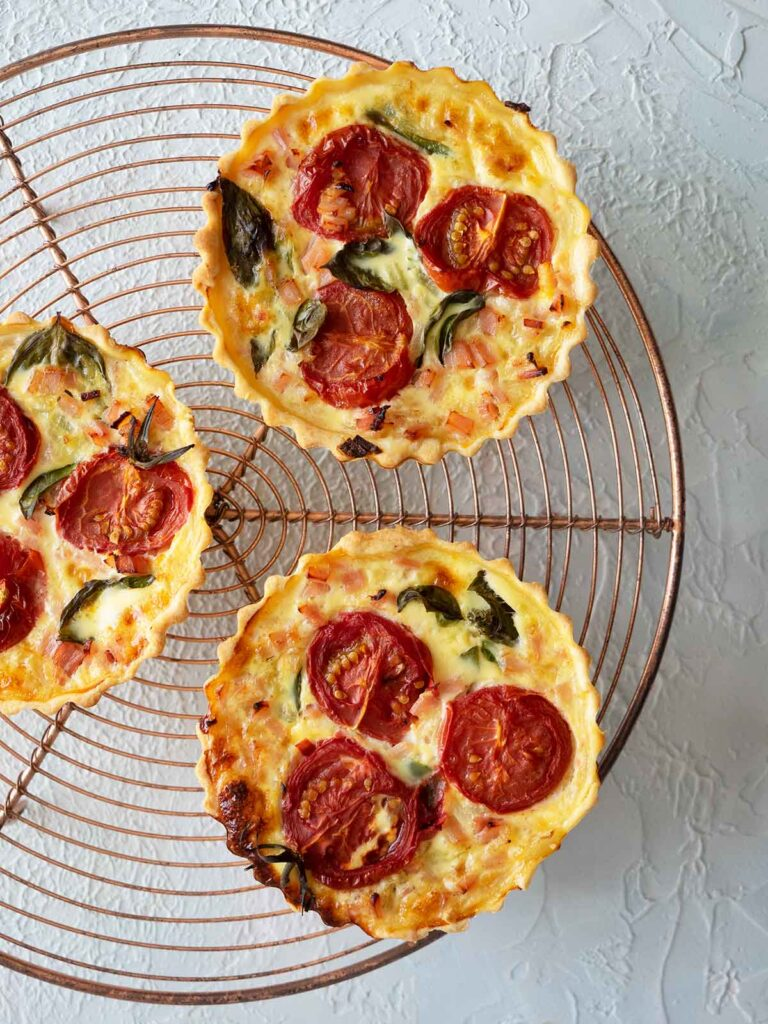 tomato tarts on a round wire cooling rack