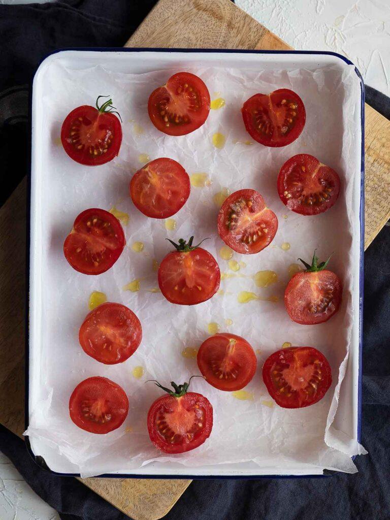 tomatoes on white roasting tray