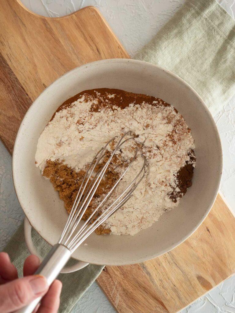 whisking dry ingredients in a ceramic bowl