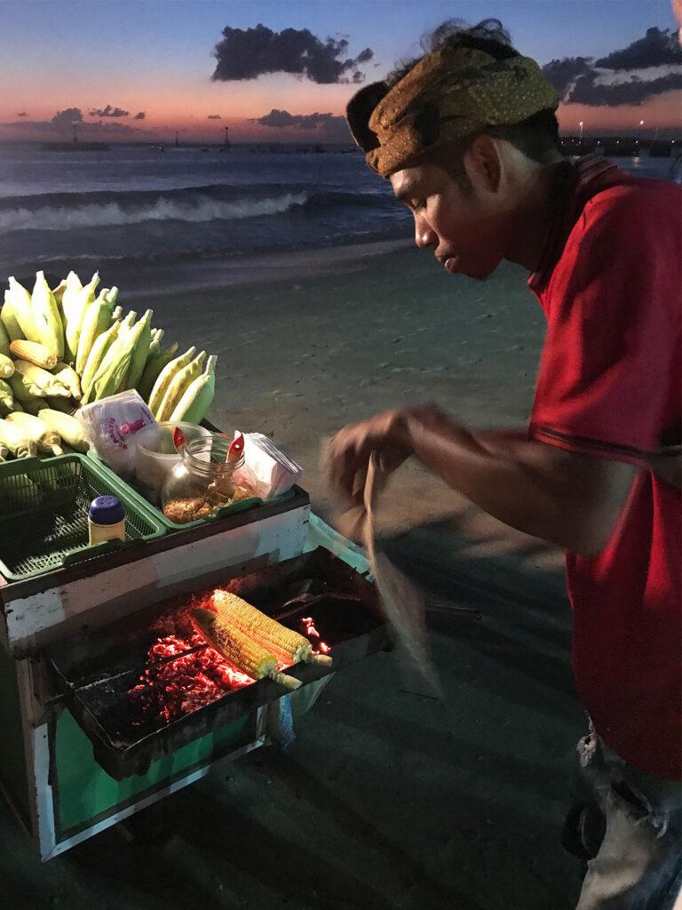 Corn seller on Jimberan Beach, Bali