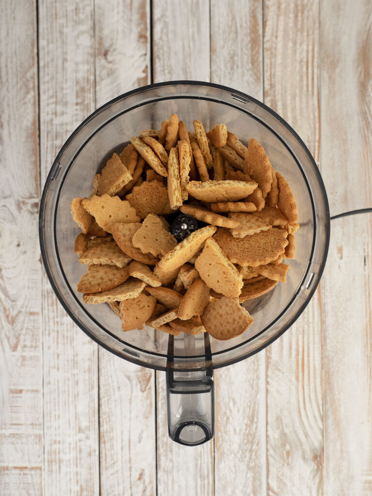 biscuits in a food processor ready to crush