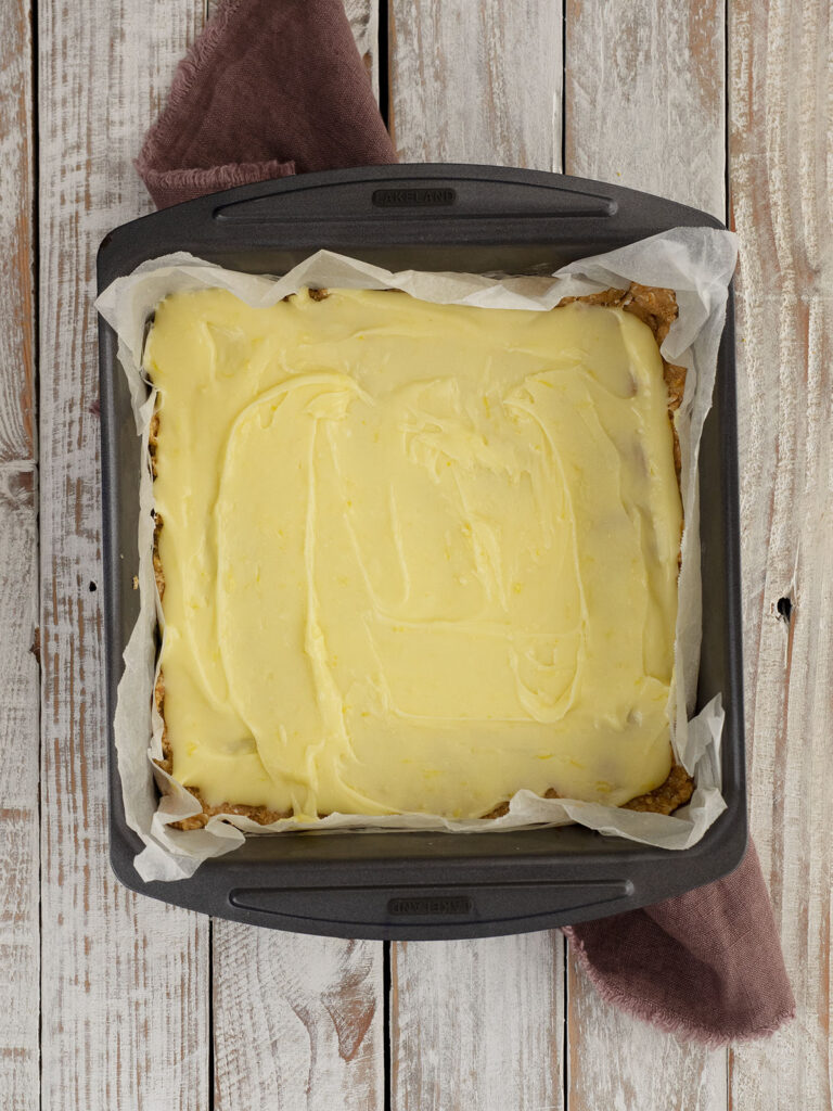 lemon slice frosted with icing in the tin
