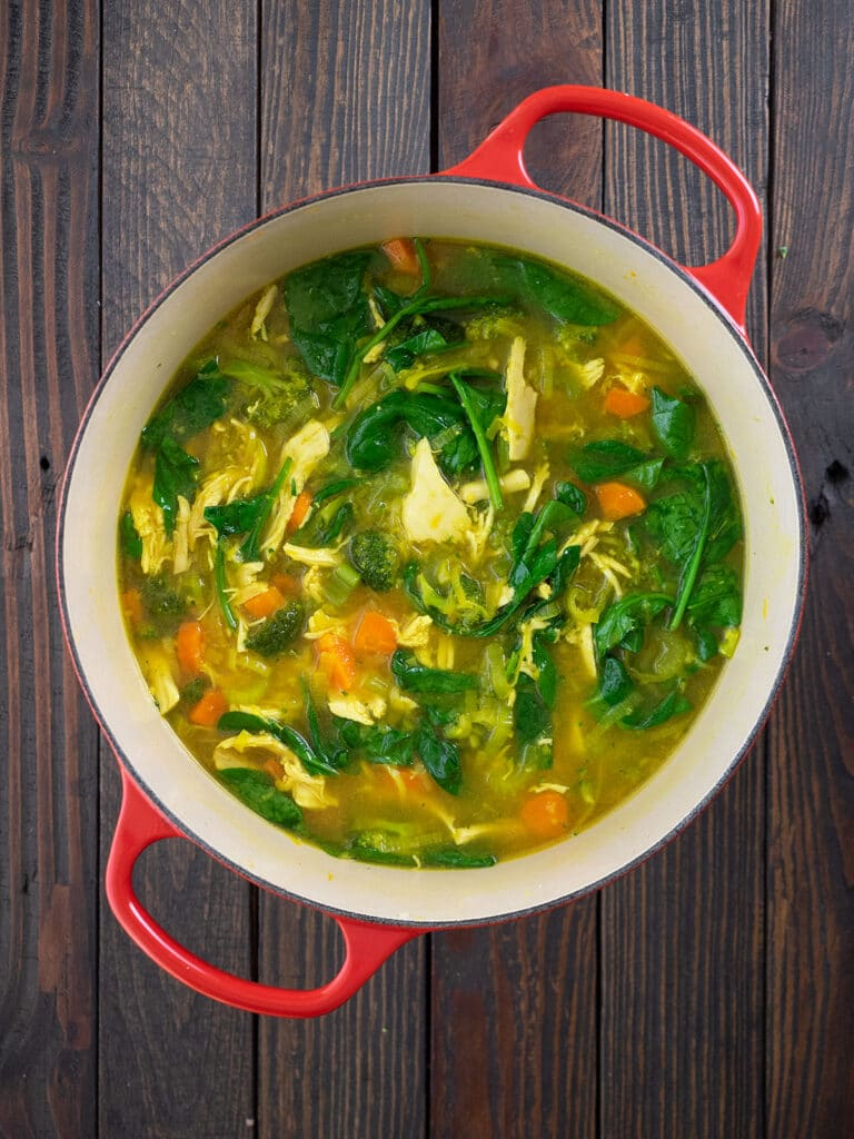 all ginger chicken soup ingredients are mixed together in the dutch oven