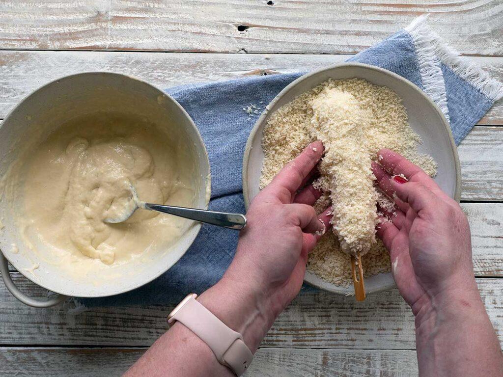 coating korean corn dog with panko crumbs