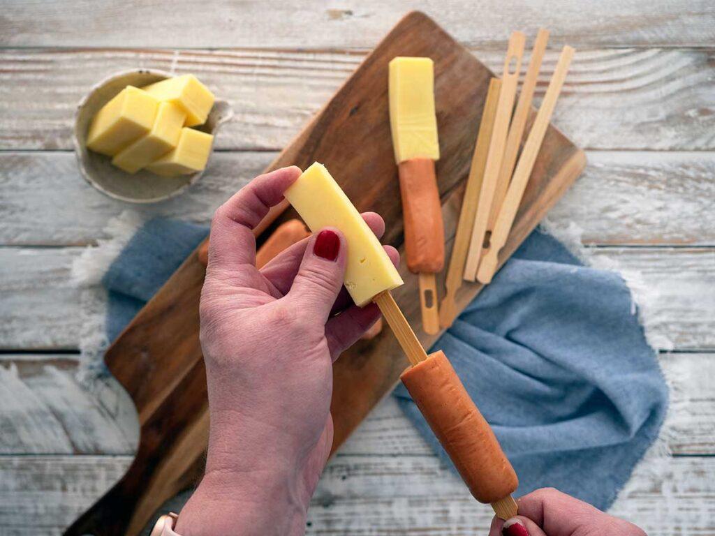 threading a stick of mozzarella onto a chopstick