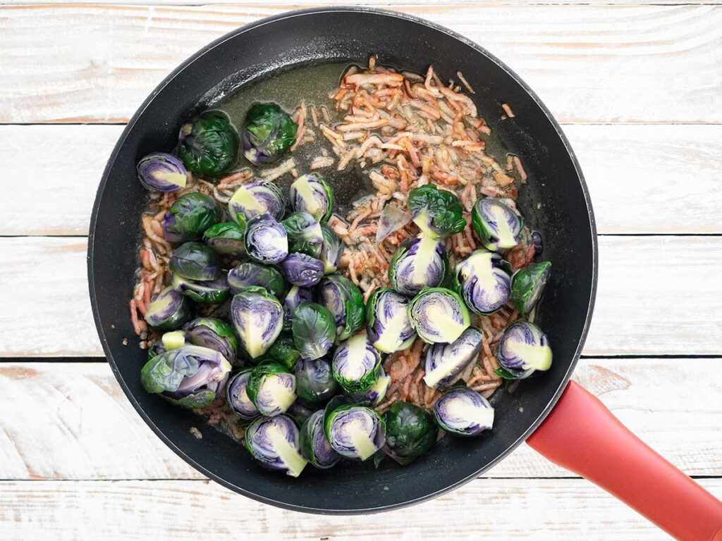 adding sprouts to the fry pan