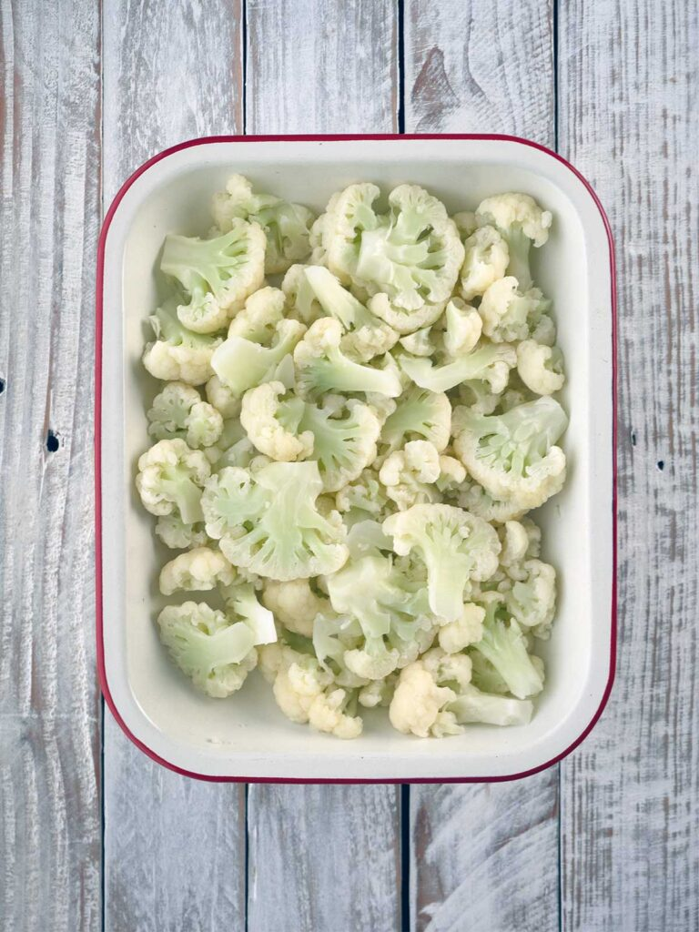 cauliflower laid out in a baking dish
