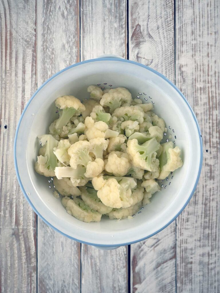blanched strained cauliflower in a colander