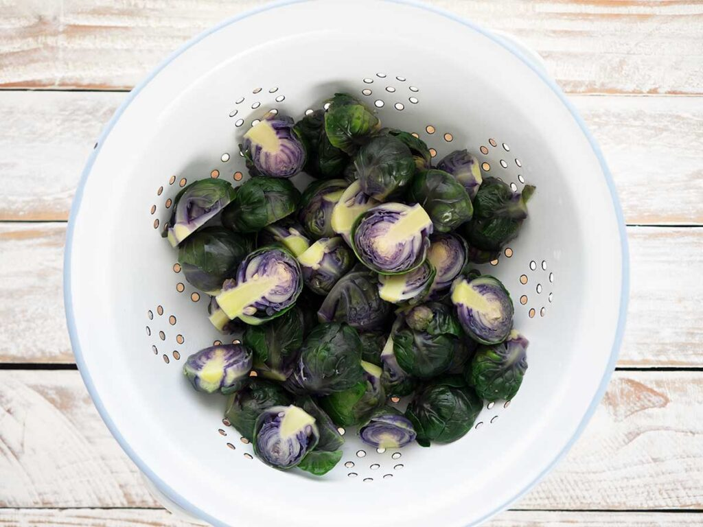 draining brussels sprouts in a colander