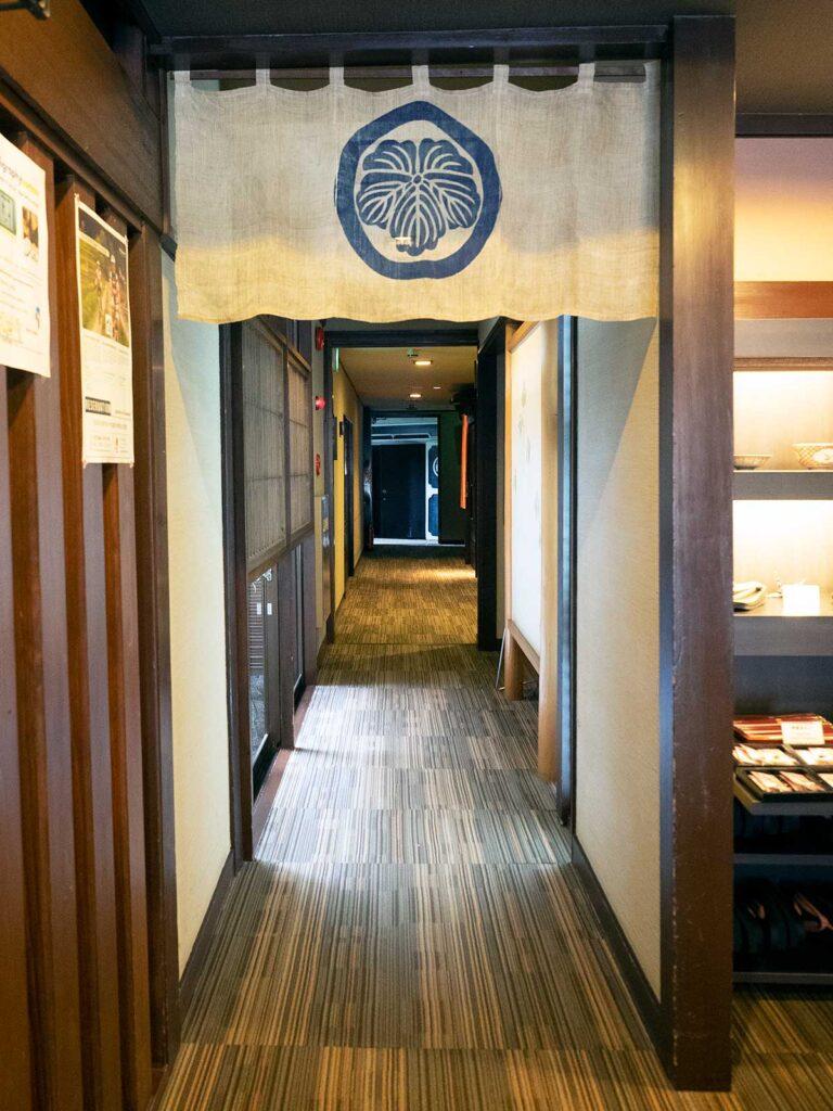 hall leading to hot baths at tanabe ryokan