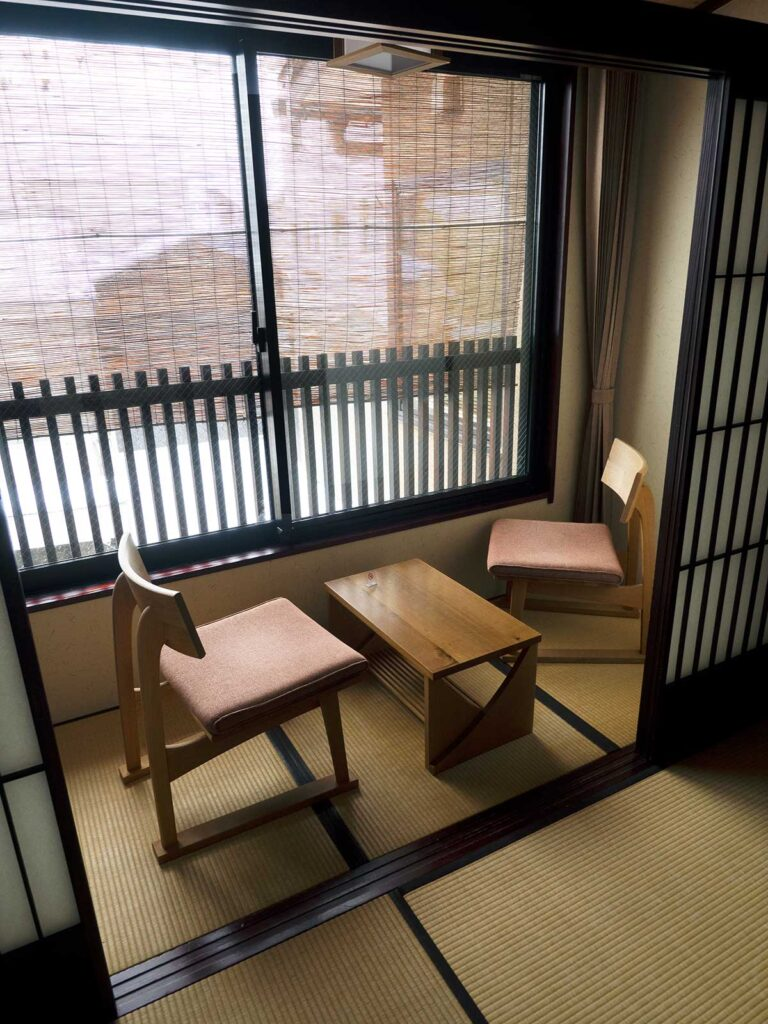 two chairs and table in a sitting nook in front of a window